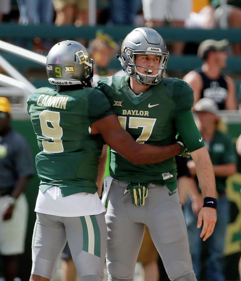 FILE - In this Saturday, Oct. 15, 2016, file photo, Baylor wide receiver KD Cannon (9) and quarterback Seth Russell (17) celebrate a touchdown scored by Russell against Kansas in the first half of an NCAA college football game, in Waco, Texas. Russell went through concussion protocol Monday, Oct. 31, and said he expects to play for the 13th-ranked Bears against TCU this week. (AP Photo/Tony Gutierrez, File) Photo: Tony Gutierrez, STF / Copyright 2016 The Associated Press. All rights reserved.