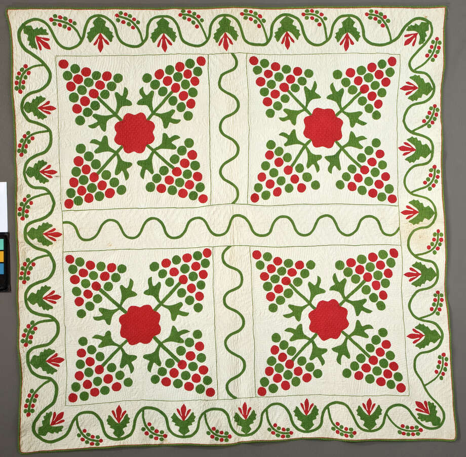 """Foundation Rose & Pine Tree Variation, artist unknown, c. 1860. From the exhibit and book """"Christmas Quilts, Christmas Memories"""" at the 2016 International Quilt Festival. Photo: International Quilt Festival"""