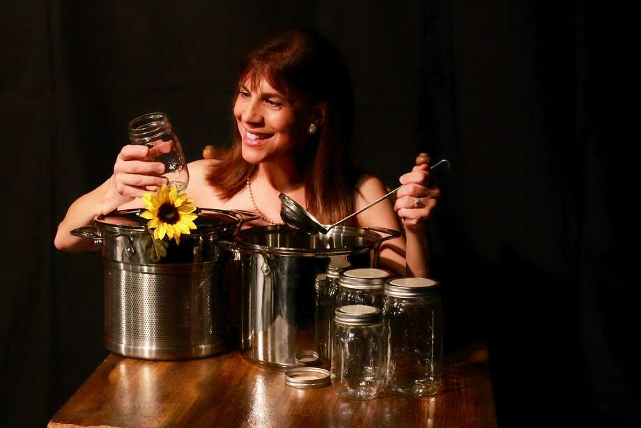 "Ruth (Mary Lou Torre) may be shy, but a little liquid courage helps her get ready for a slightly risque photo in City Lights Theater Company's ""Calendar Girls."" Photo: Taylor Sanders, City Lights Theater Company"