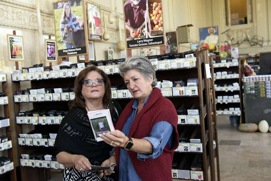 Vickie Horne (left) of Nashville and Deby Pitts of Dallas shop for seeds while visiting the Petaluma Seed Bank. Photo: Michael Short, Special To The Chronicle