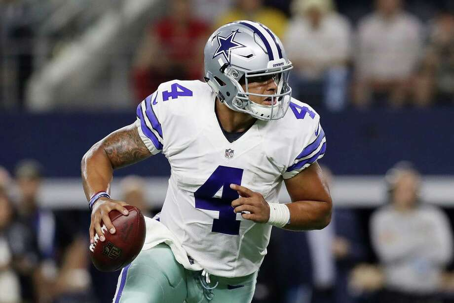 ARLINGTON, TX - OCTOBER 30:  Dak Prescott #4 of the Dallas Cowboys runs in the third quarter during a game between the Dallas Cowboys and the Philadelphia Eagles at AT&T Stadium on October 30, 2016 in Arlington, Texas.  (Photo by Ronald Martinez/Getty Images) Photo: Ronald Martinez, Staff / 2016 Getty Images