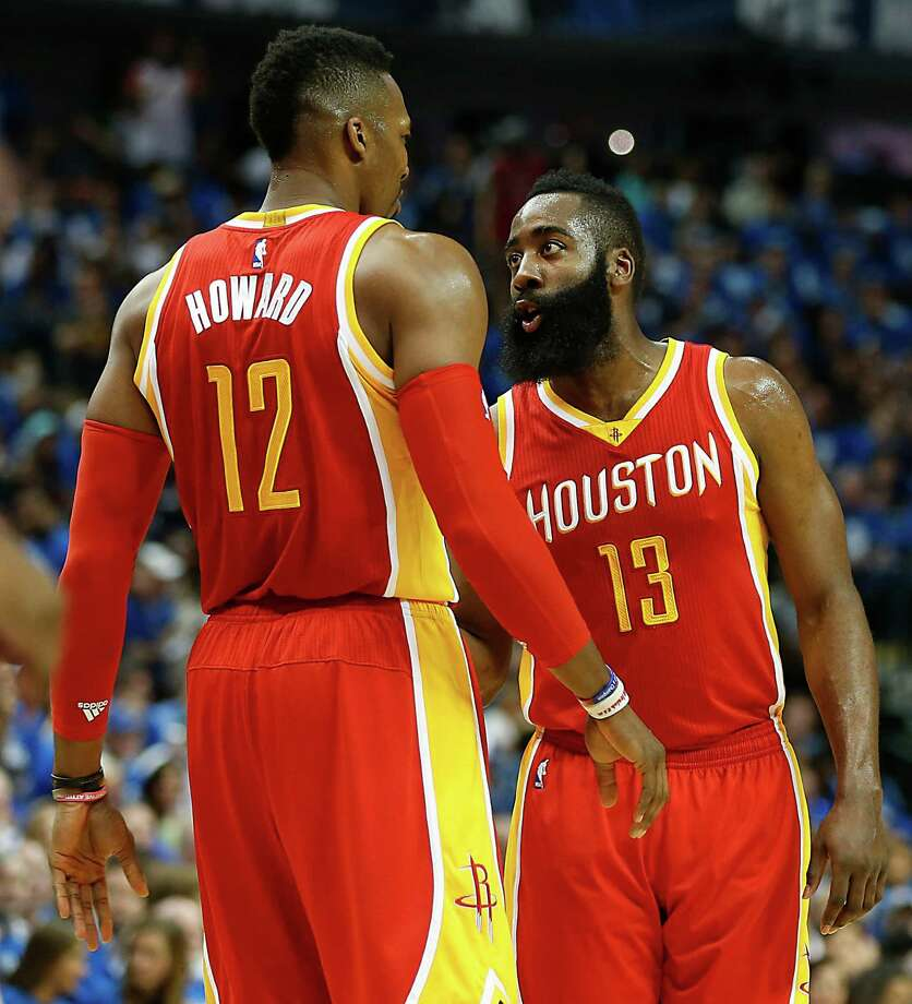 Houston Rockets center Dwight Howard  left, and Rockets guard James Harden during the first half of Game 4 in the first round of NBA basketball playoffs against the Dallas Mavericks at the American Airlines Center Sunday, April 26, 2015, in Dallas.