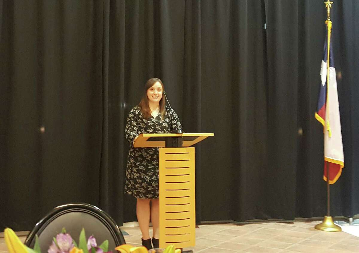 Meagan Silva Hartwick explains how the East Montgomery County Scholarship Foundation helped her in her college career during the East Montgomery County Scholarship Foundation Gala held at the East Montgomery County Improvement District Complex in New Caney Tuesday, Nov. 1.