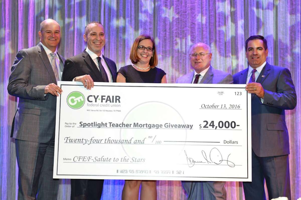 Lansing Brown, a special education teacher at Cypress Falls High School, accepted a surprise award to receive a year's worth of mortgage payments totaling $24,000 ($2,000 every month for 12 months) from Cy-Fair FCU.