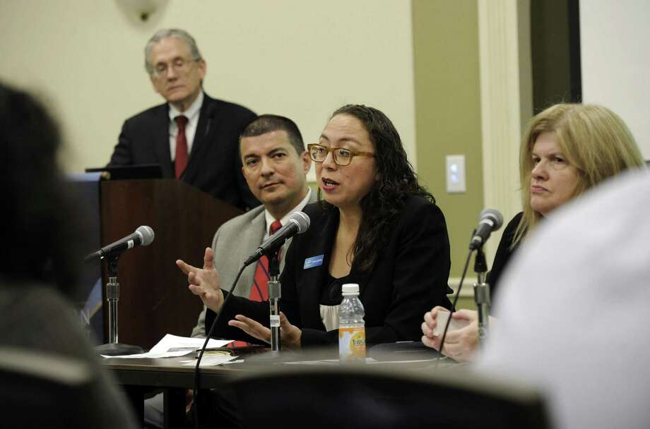 "Monica Guevara, center, is part of a panel during a seminar called ""Access to Capital for Small Business"" held at Western Connecticut State University Tuesday, Nov. 1, 2016. Also on the panel are Nelson Merchan, left, and Sheila Hummel. Robert Barghause, instructor of finance at the university, far left, is the moderator. Photo: Carol Kaliff / Hearst Connecticut Media / The News-Times"