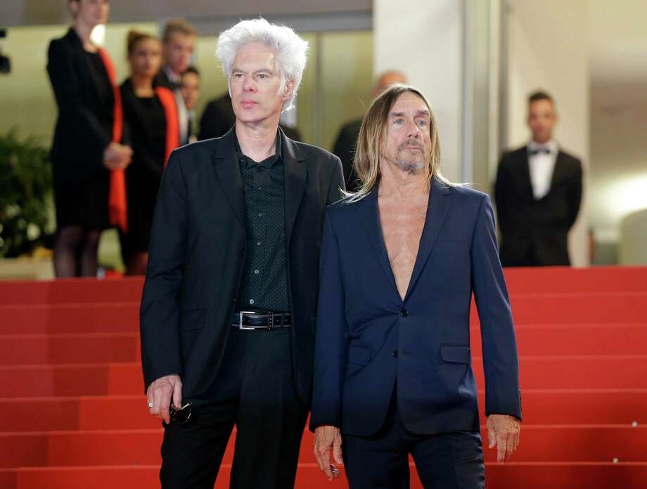 "FILE - In this May 20, 2016 file photo, director Jim Jarmusch, left and singer Iggy Pop, pose at the screening of the film ""Gimme Danger,"" at the 69th international film festival, Cannes, southern France. The film premieres Friday, Oct. 28, 2016, in Detroit and New York. (AP Photo/Lionel Cironneau, File) ORG XMIT: NYET321 Photo: Lionel Cironneau / Copyright 2016 The Associated Press. All rights reserved."