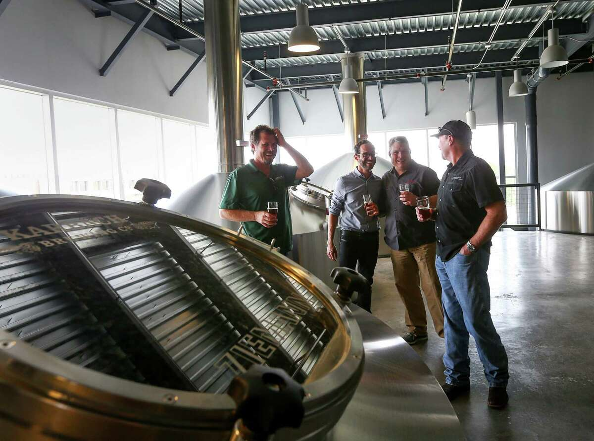 Eric Warner, brewmaster at Karbach Brewing Co., from left, Felipe Szpigel, president of Anheuser-BuschInBez's High End business unit, and Ken Goodman and Chuck Robertson, both co-founders of Karbach Brewing Co., laugh as they stand in the brewhouse at Karbach brewery, Thursday, Nov. 3, 2016, in Houston. Anheuser-Busch announced that they will acquire Karbach Brewing Co. ( Jon Shapley / Houston Chronicle )