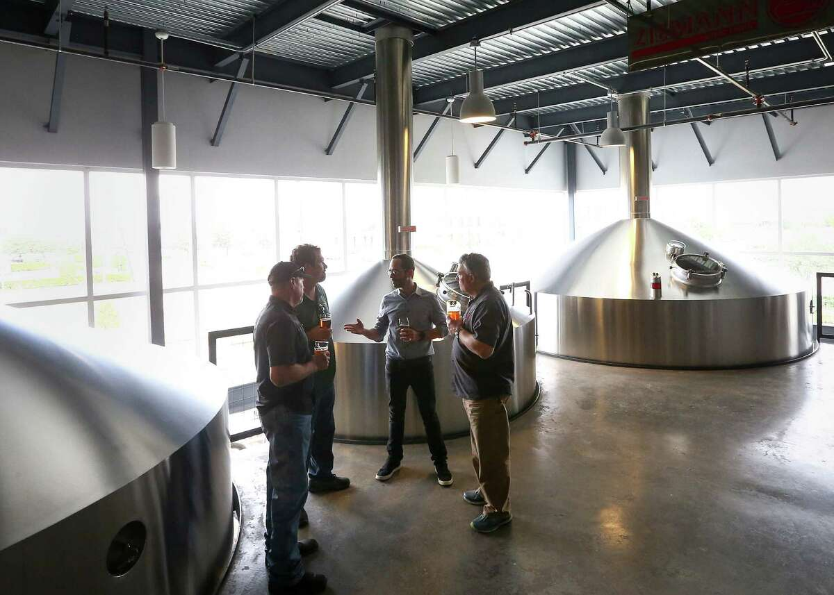Chuck Robertson, from left, co-founder of Karbach Brewing Co., Eric Warner, brewmaster at Karbach Brewing Co., Felipe Szpigel, president of Anheuser-BuschInBez's High End business unit, and Ken Goodman, co-founder of Karbach Brewing Co., talk as they stand in the brewhouse at Karbach brewery, Thursday, Nov. 3, 2016, in Houston. Anheuser-Busch announced that they will acquire Karbach Brewing Co. ( Jon Shapley / Houston Chronicle )