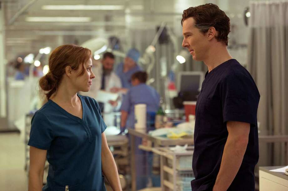 "This image released by Disney shows  Rachel McAdams, left, and Benedict Cumberbatch in a scene from Marvel's ""Doctor Strange."" ( Jay Maidment/Disney/Marvel via AP) ORG XMIT: NYET810 Photo: Jay Maidment / null"