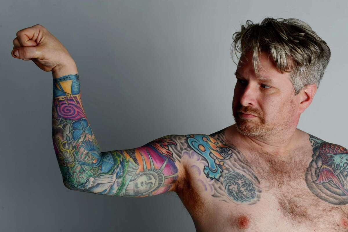 Mycroft Sowizral of Colonie, who has many New York State iconic tattoos, is pictured on Thursday, June 23, 2016, at the Times Union in Colonie, N.Y. (Will Waldron/Times Union)