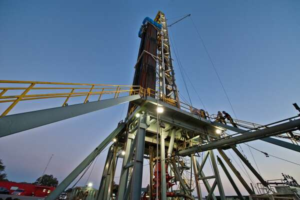 An oil & gas drilling rig is drilling a well for Pioneer Natural Resources.