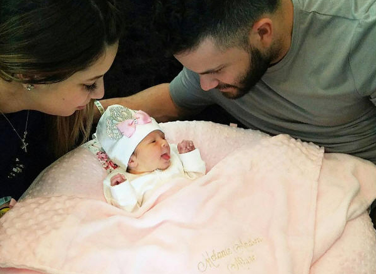 Houston Astros second baseman Jose Altuve with wife Giannina and new born baby girl Melanie. Photo posted November 2016. Source: Instagram