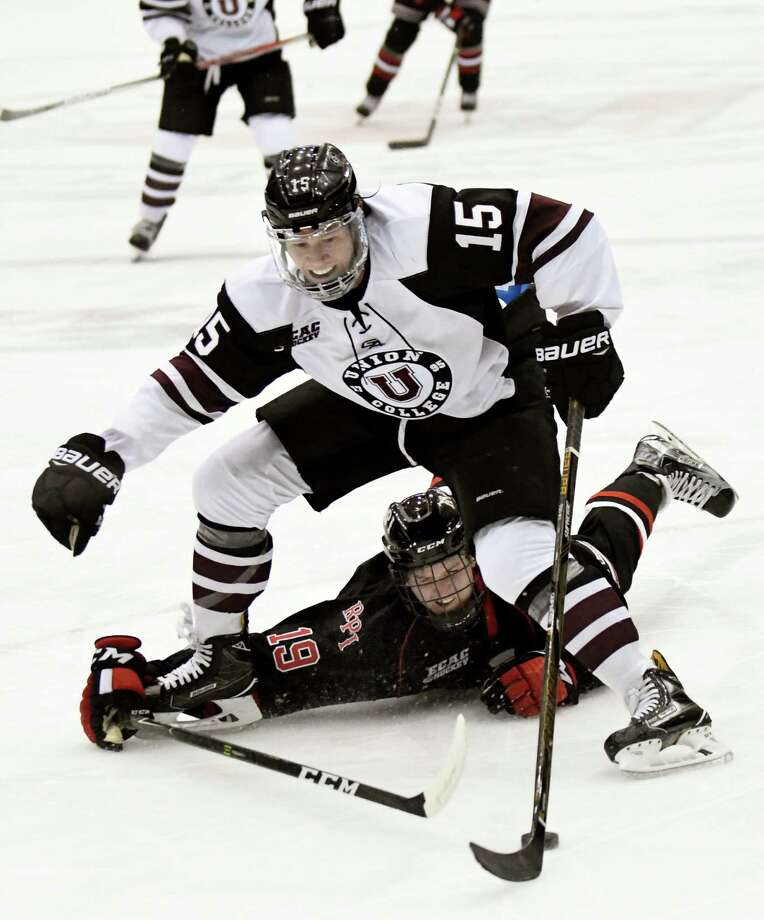 Union's Spencer Foo, center, works the puck as RPI's Mike Prapavessis defends during their hockey game on Friday, Oct. 28, 2016, at Houston Field House in Troy, N.Y. (Cindy Schultz / Times Union) Photo: Cindy Schultz / Albany Times Union