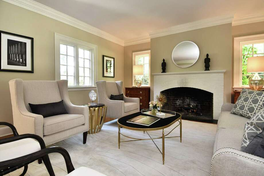 The formal living room has one of the house's three fireplaces. Photo: /
