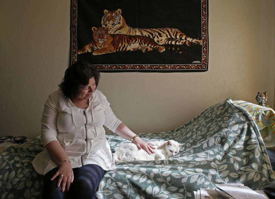 Bianca Stojkova, a tenant at the Rosa Parks apartments at 1251 Turk St. in San Francisco, California, at her apartment with her cat Kitka on Thursday November 3, 2016 Photo: Michael Macor, The Chronicle