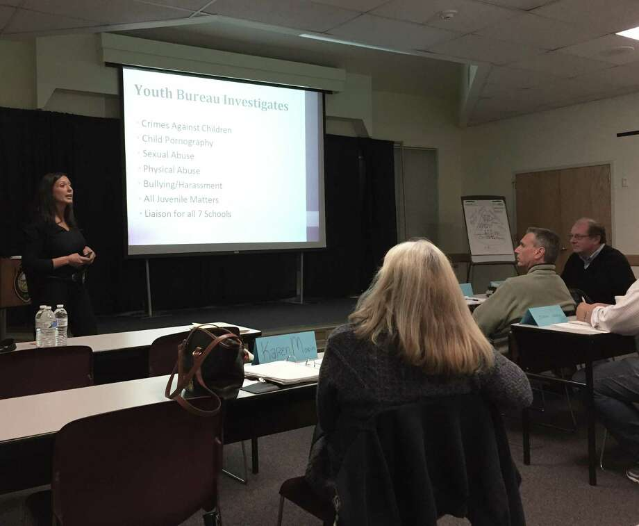 Sgt. Sereniti Dobson presents on the police's Youth Bureau during the eighth week of the Westport, Conn. Citizens' Police Academy on Oct. 27, 2016. Photo: Laura Weiss / Hearst Connecticut Media / Westport News