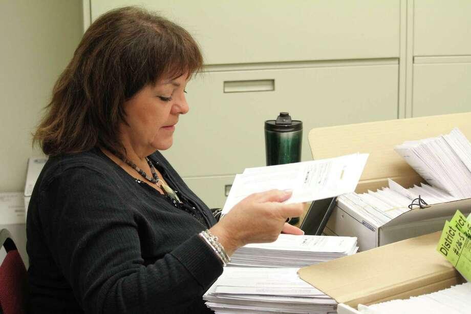 Deputy Town Clerk Ruth Cavayero organizes absentee  ballots in Westport Town Hall on Nov. 1, 2016. Photo: Chris Marquette / Hearst Connecticut Media / Westport News