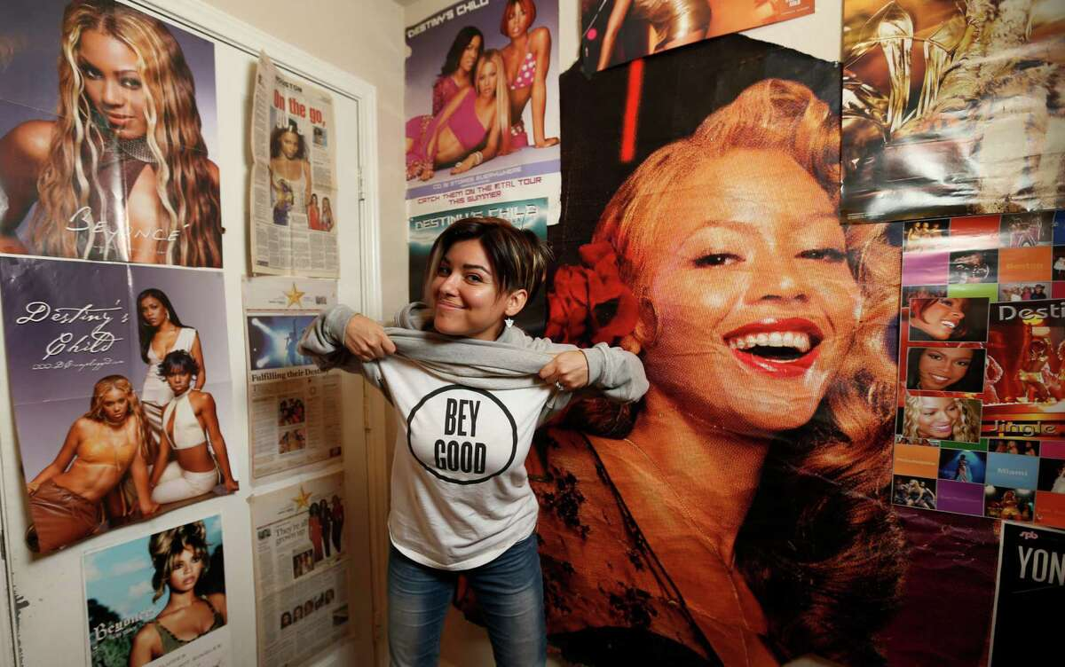 Jessica Bolaños Vanegas surrounded by her collection of Beyonce memorabilia, Tuesday, May 3, 2016, in Houston. She's a bonafide BeyHive member. Her collection of memorabilia includes literal billboards, newspaper clippings, CDs to backpacks, dolls and T-shirts.