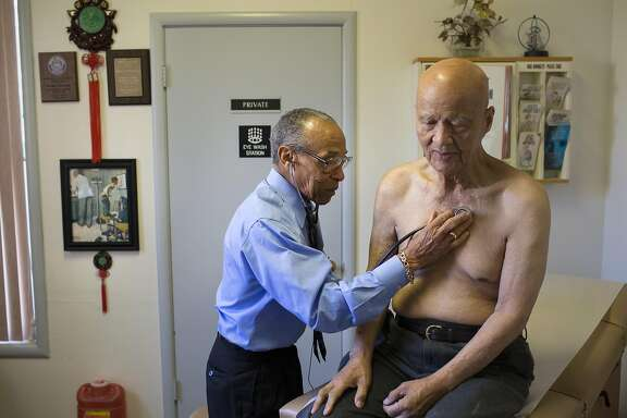 Dr. James Hutchinson, 93, listens to Diego Ope�a's heartbeat during a checkup at Hutchinson's office of 63 years on Tuesday, October 18, 2016 in San Mateo, Calif. Hutchinson, who was San Mateo county's first African American doctor, is now seeing three generations of patients.
