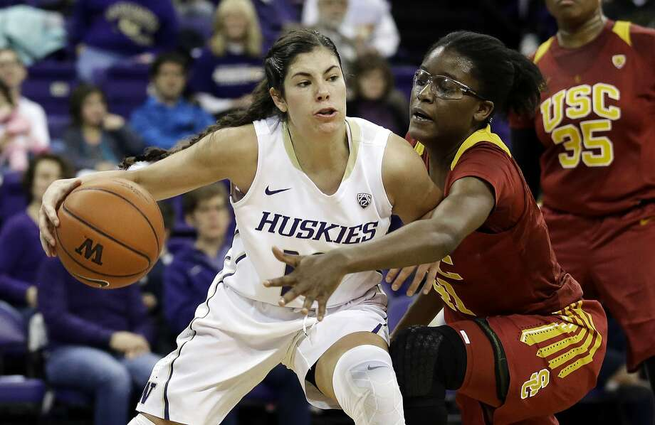 In this Jan. 17, 2016, file photo, Washington guard Kelsey Plum, left, drives around Southern California forward Temi Fagbenle. Photo: Ted S. Warren, Associated Press