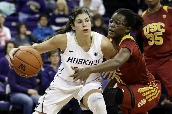 FILE - In this Jan. 17, 2016, file photo, Washington guard Kelsey Plum, left, drives around Southern California forward Temi Fagbenle, second from left, in the first half of an NCAA college basketball game, in Seattle. Plum was selected to The Associated Press women's college basketball preseason All-America team Thursday, Nov. 3, 2016. (AP Photo/Ted S. Warren, File)