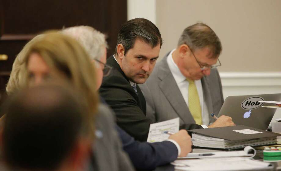 Former North Charleston Police Officer Michael Slager, second from right, sits at the defense table and listens to his lawyer in the courtroom, Thursday, Nov. 3, 2016 in Charleston, S.C. Slager faces 30 years to life if convicted of murder in the April 2015 death of Scott, whose shooting, captured on a bystander's dramatic cellphone video, spread on social media and stunned the nation. (Grace Beahm/Post and Courier via AP, Pool, File) Photo: Grace Beahm, POOL / Post and Courier POOL