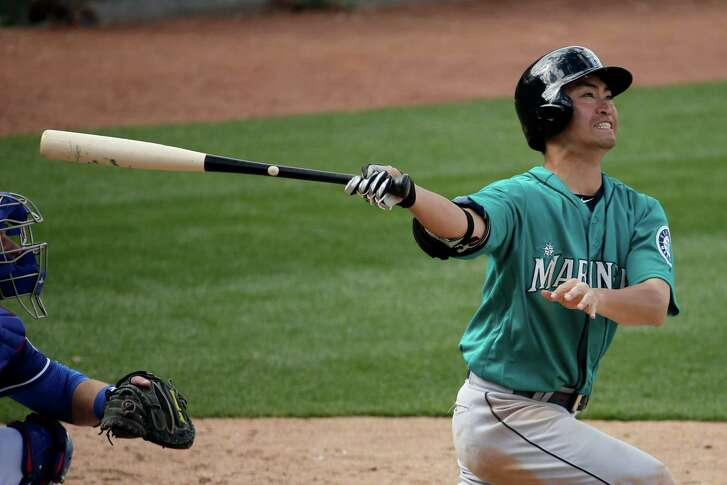 Seattle Mariners' Nori Aoki bats during the sixth inning of a spring training baseball game against the Texas Rangers Sunday, March 6, 2016, in Surprise, Ariz.