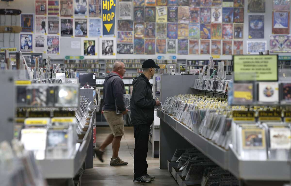 Customers browse in the aisles at the Amoeba music and record store on Haight Street in San Francisco, Calif. on Nov. 3, 2016.
