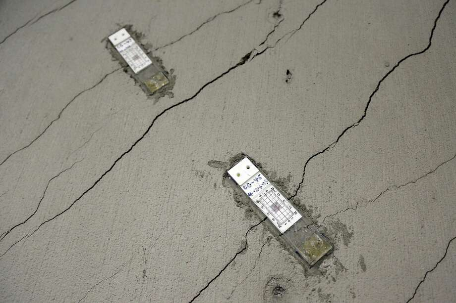 Stress gauges are placed along a wall with floor-to-ceiling cracks in the parking garage of the Millennium Tower in San Francisco.  Photo: Eric Risberg, Associated Press