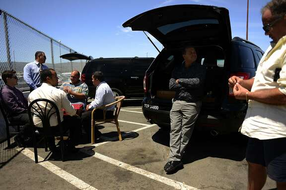 Uber drivers relax at SFO Airport in San Francisco, California, on Wednesday, June 17, 2015.