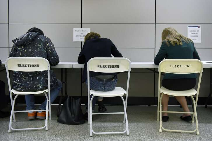 People take part in early voting at City Hall in San Francisco, CA, November 2, 2016.