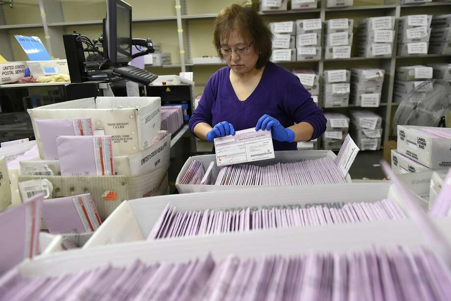 Election clerk Sachi Manalisay sorts mail in ballots in a sorting room at City Hall in San Francisco, CA, November 2, 2016. Photo: Michael Short, Special To The Chronicle