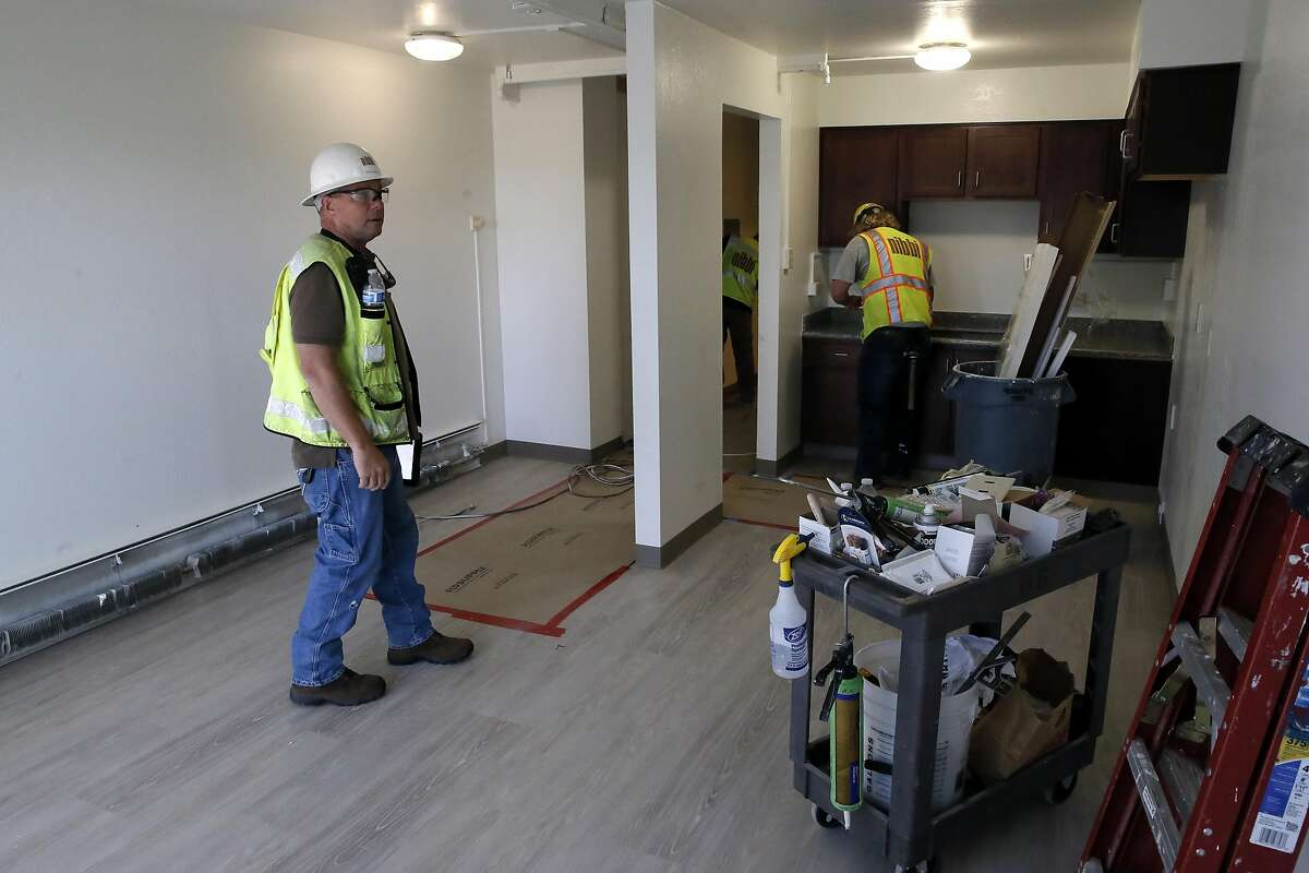 Project manager Brian Burke, (left) oversees the renovations taking place at Mercy Housing at 345 Arguello in San Francisco, California, as seen on Thursday November 3, 2016