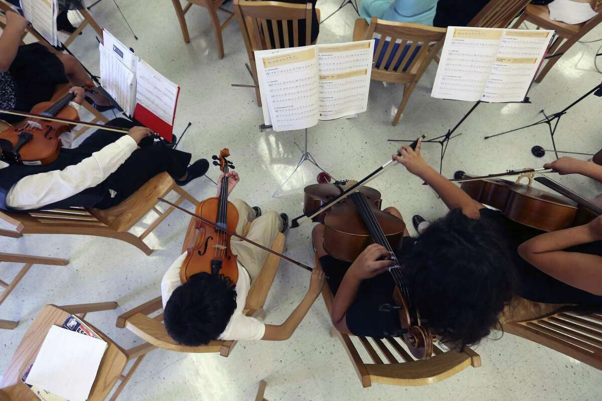 Winston Elementary students play their during an event to thank the Youth Orchestras of San Antonio. The nonprofit recently donated 56 violins and 21 cellos to the Winston Strings Program,