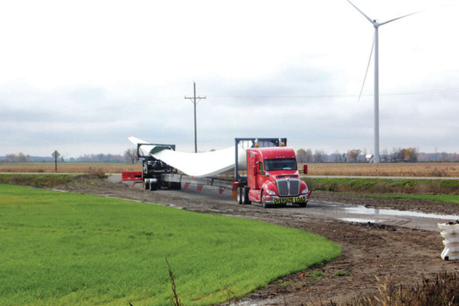 A new blade is transported Thursday to a turbine site in Bloomfield Township.