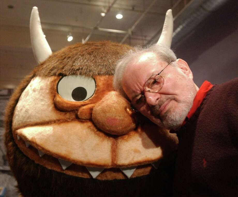 """Standing with a character from his book """"Where the Wild Things Are,"""" author and illustrator Maurice Sendak speaks with the media in January 2002 before the opening of an exhibition entitled, """"Maurice Sendak In His Own Words and Pictures,"""" at the Childrens Museum of Manhattan in New York City.  Sendak's estate has exercised an option to reclaim some 10,000 drawings from a museum in Philadelphia, to eventually build a museum in Ridgefield, Conn. Photo: Spencer Platt / Spencer Platt /Getty Images / Photo by Spencer Platt/Getty Images Getty Images"""