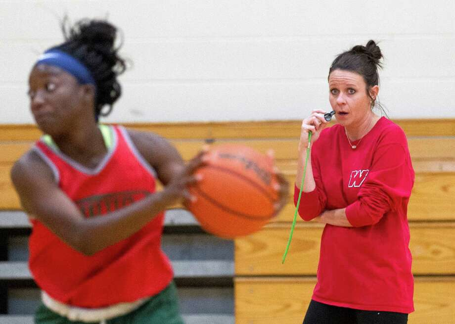 The Woodlands head coach Trista Tastch watches players during drill at The Woodlands High School Thursday, Oct. 27, 2016, in The Woodlands. Tastch, who has been an assistant girls basketball coach at The Woodlands for 17 years, takes over for Dana Bruton, who retired after 11 seasons as head coach. Photo: Jason Fochtman, Staff Photographer / Houston Chronicle