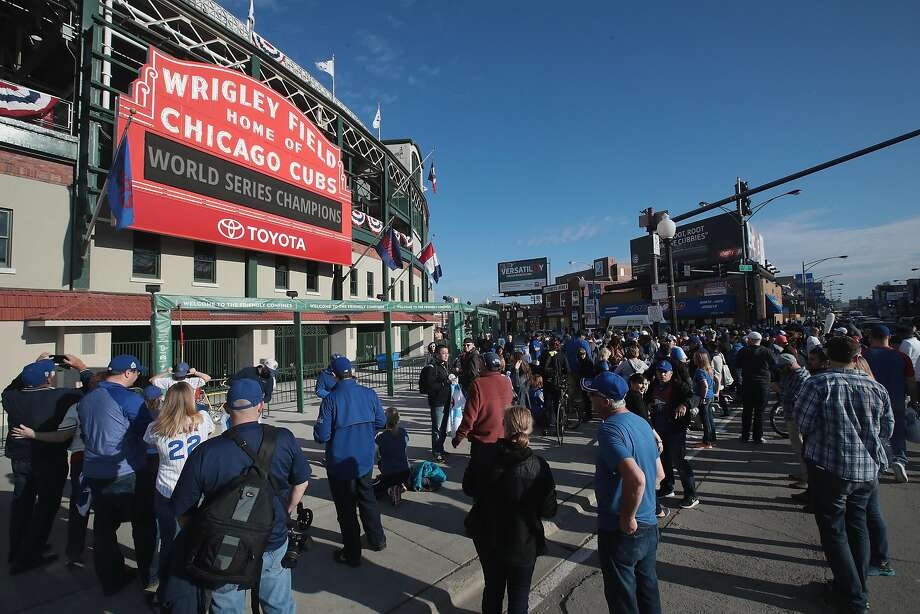 Chicago Cubs fans gathered at Wrigley Field on Thursday, the day after the Cubs defeated the Indians in Game 7 at Cleveland to win their first World Series title since 1908. Photo: Scott Olson, Getty Images