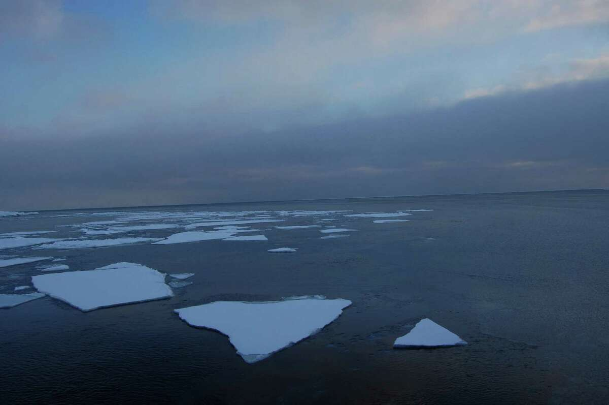 In this photo provided by Dirk Notz, taken April 21, 2009, ice floats in the Arctic near Svalbard, Norway. At current carbon emission levels, the Arctic will likely be free of sea ice in September around mid-century, which could make weather even more extreme and strand some polar animals, a study published Thursday in the journal Science finds. (Dirk Notz via AP)