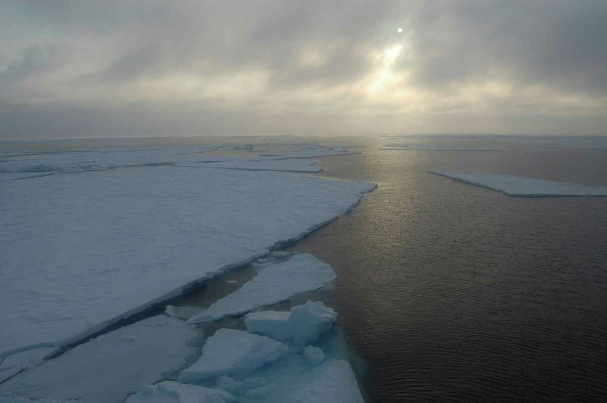 In this photo provided by Dirk Notz, taken, April 23, 2009, ice floats in the Arctic near Svalbard, Norway. At last year's carbon emission levels, the Arctic will likely be free of sea ice around mid-century, which could make weather even more extreme and strand some polar animals, a study published Thursday in the journal Science finds. (Dirk Notz via AP)