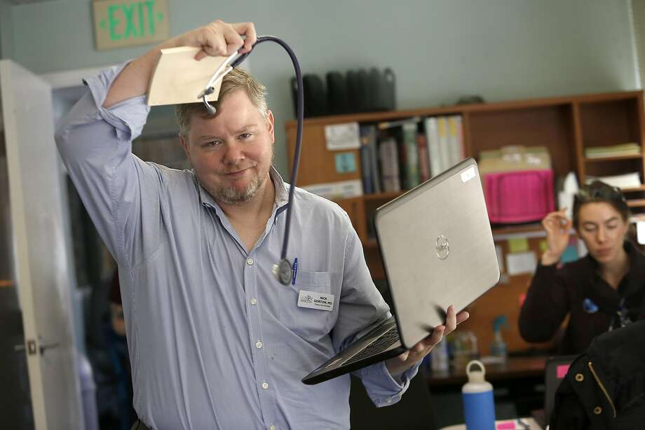 Dr. Nick Gorton, a primary care provider, gets ready to see a patient at Lyon-Martin in S.F. Photo: Liz Hafalia, The Chronicle