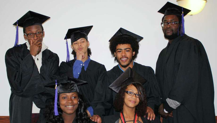 On Oct. 28, members of CEO's YouthBuild program received their certificate of completion in a graduation ceremony held at CEO's Community Resource Center in Troy. Pictured, from left in the back, are Deon Pitt, Christian Vargas, Michael Smith, Ishmael Foster and front are Shakirra Byrd and Acharu Major. The ceremony also recognized participants who went above and beyond the requirements of the program. Past graduates were also honored for obtaining and maintaining employment. YouthBuild is a workforce development program for young people ages 16 to 24 that offers job training, education and case management to assist participants in removing barriers to employment. (Submitted photo)