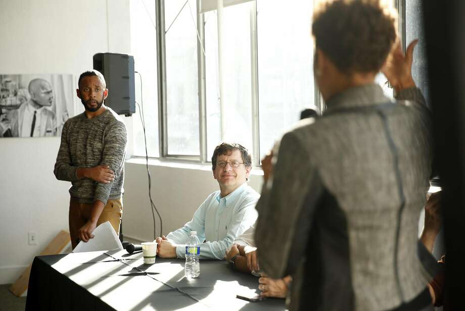 Uber's Jordan Medina, Community Outreach & Engagement Lead, and Adony Beniares, Head of Global Workplace, listen as Shonda Scott, CEO, 360 Total Concept, introduces them during an event for prospective contractors for Uber's new headquarters on Broadway in Oakland, Calif., on Thursday, November 3, 2016. Photo: Scott Strazzante, The Chronicle