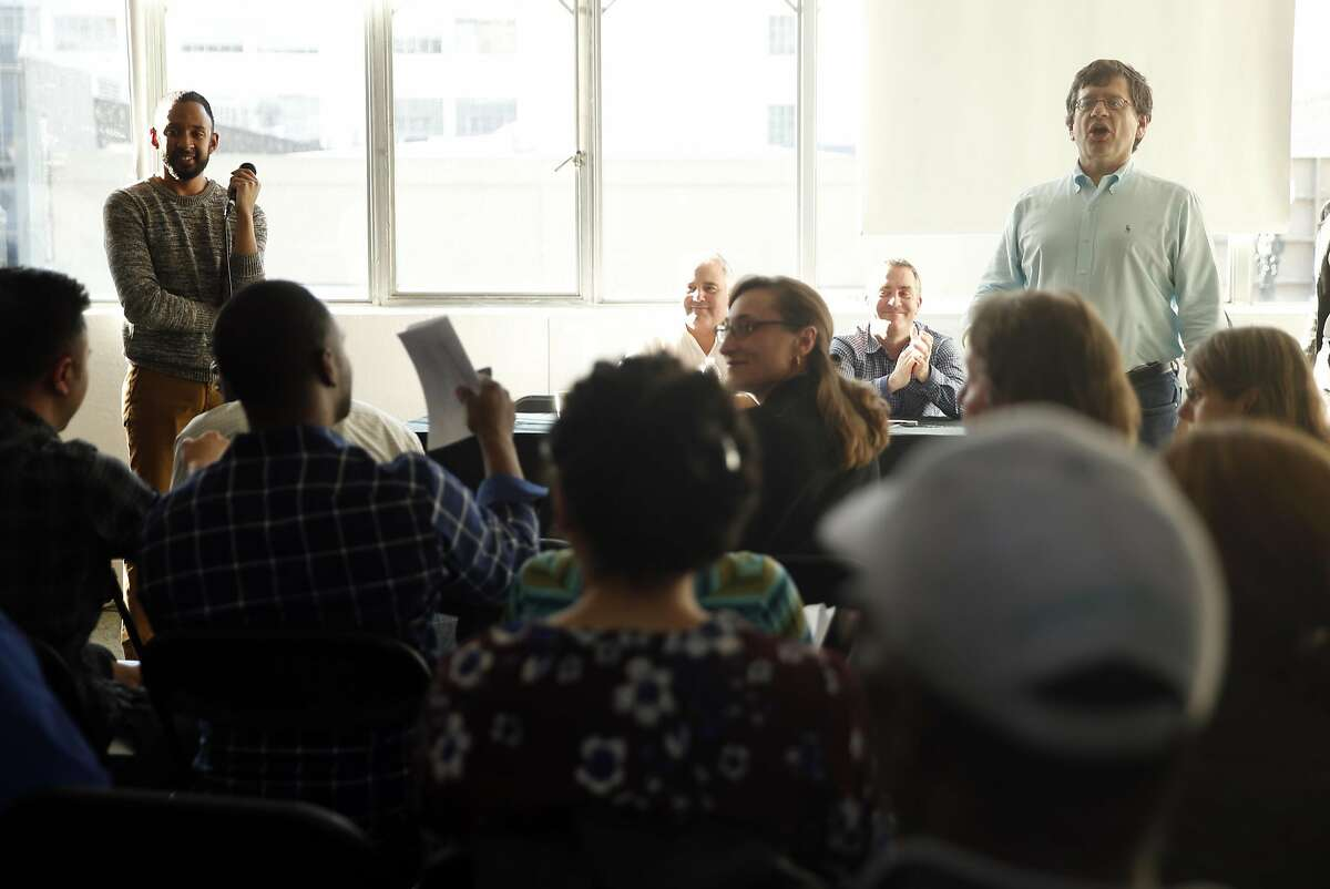 Uber's Adony Beniares, Head of Global Workplace, (right) and Jordan Medina, Community Outreach & Engagement Lead, speak during an event for prospective contractors for Uber's new headquarters on Broadway in Oakland, Calif., on Thursday, November 3, 2016.
