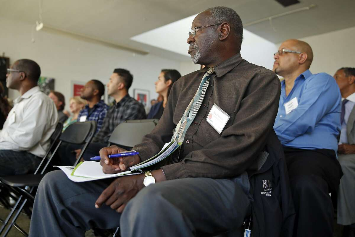 Bruce Stewart of MP Concrete Construction listens as Uber hosts an event for prospective contractors for their new headquarters on Broadway in Oakland, Calif., on Thursday, November 3, 2016.