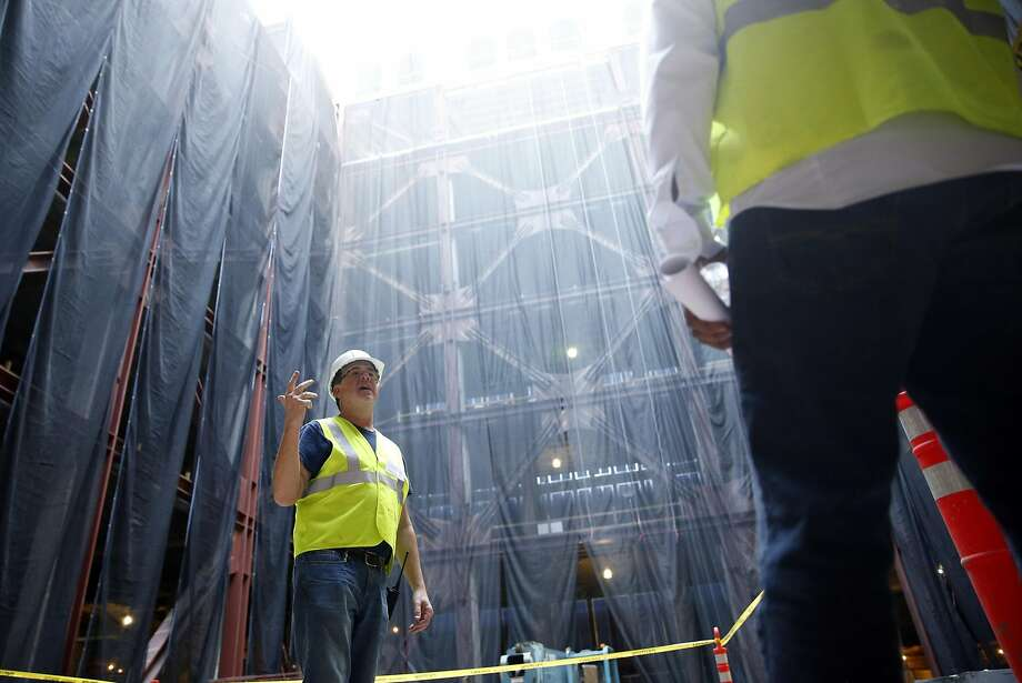 Chris Robbins, RiverRock Real Estate Group's operating manager, leads a tour of Uber's future Oakland headquarters. Photo: Scott Strazzante, The Chronicle