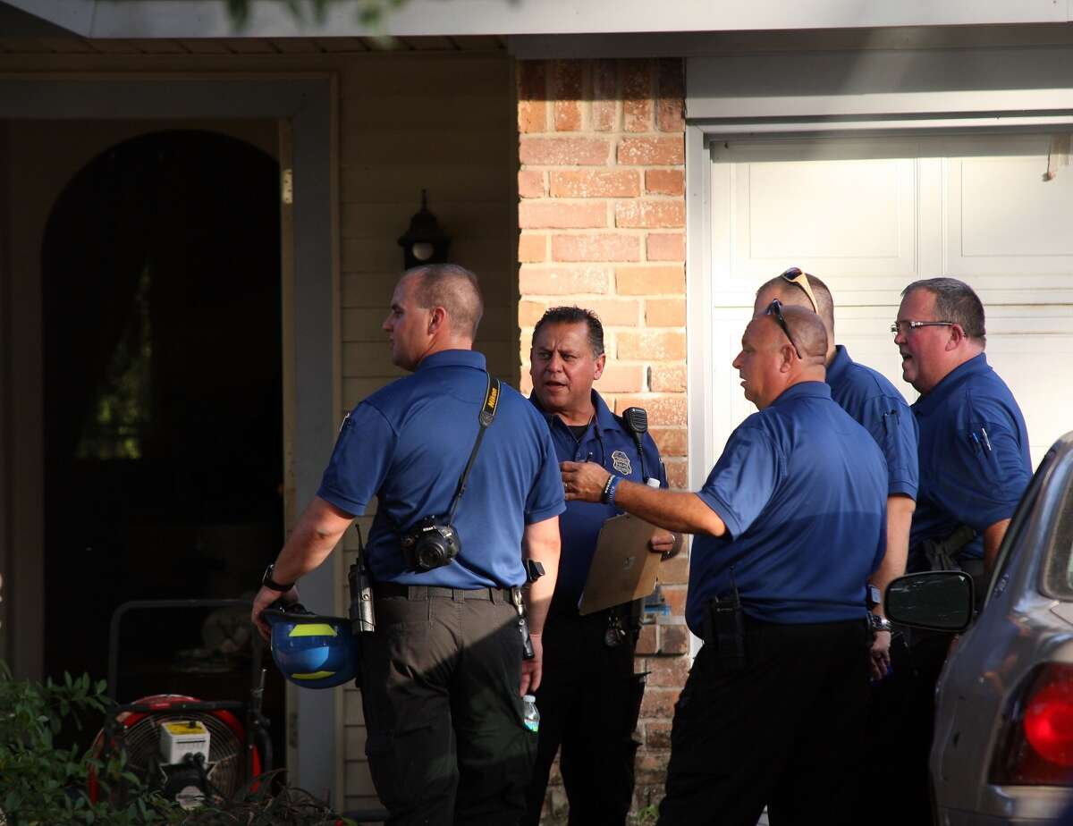 An officer tried to save a man believed to be trapped inside a burning home in the 5000 block of Parkland on Thursday.
