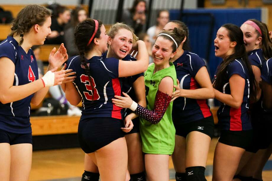 Brien McMahon celebrates their victory over Greenwich in the FCIAC volleyball semifinals at Fairfield Ludlow High School in Fairfield, Conn. Thursday night. Photo: Chris Palermo / For Hearst Connecticut Media / Greenwich Time Freelance