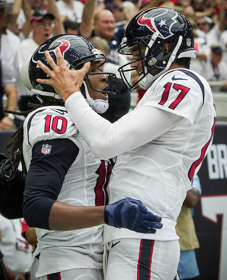 For the Texans to soar over the second half of their schedule, wide receiver DeAndre Hopkins, left, and quarterback Brock Osweiler must do a better job of getting on the same page in the playbook. Photo: Brett Coomer, Staff / © 2016 Houston Chronicle
