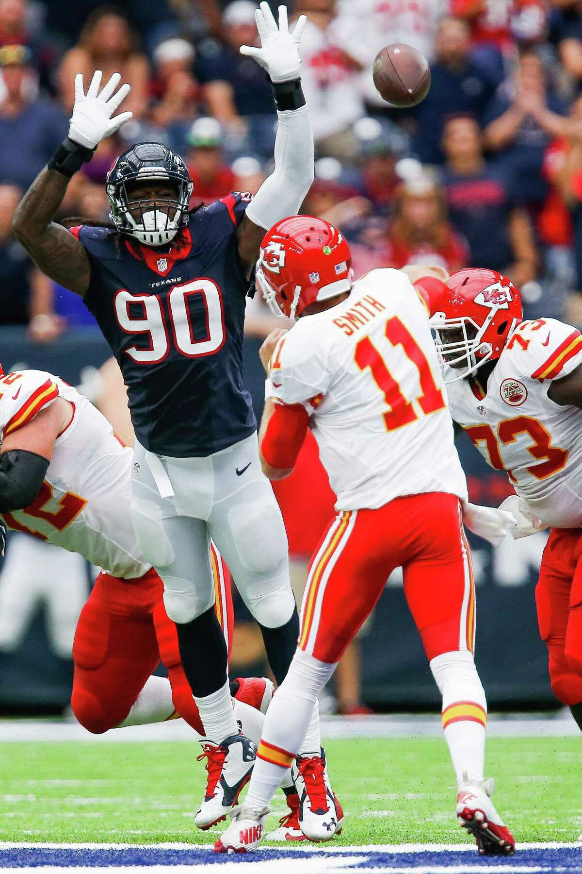 With fellow defensive end J.J. Watt on injured reserve, Jadeveon Clowney, left, has helped pick up the slack for a unit ranked second in the NFL against the pass but only 29th against the run.